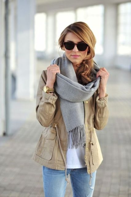 Nice casual winter outfit with white t-shirt, beige jacket and jeans