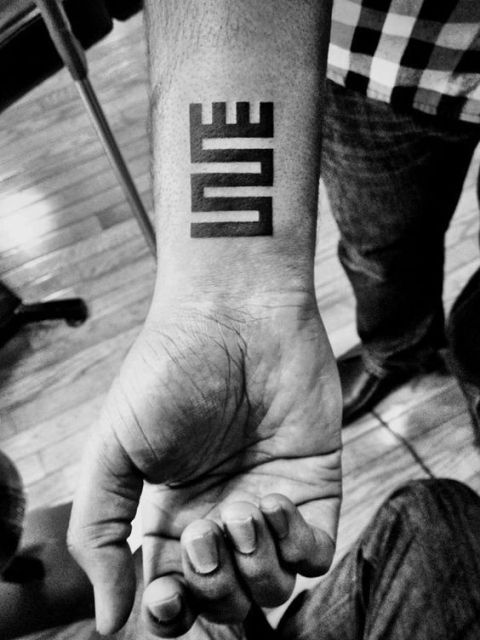 Word love tattoo