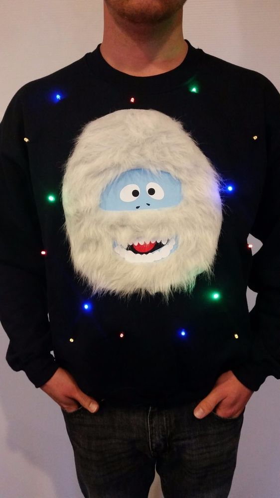 black sweater with white fur monster and lights