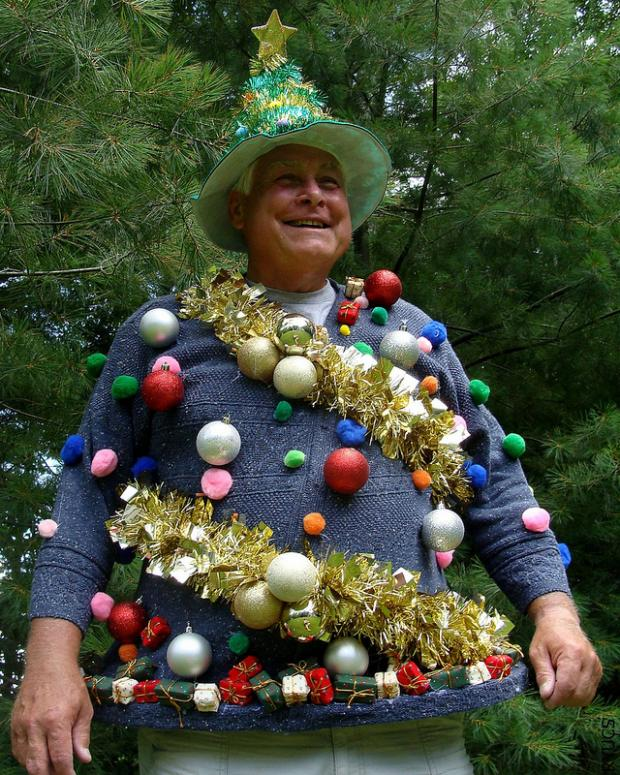 blue sweater with ornaments and a bold glitter hat