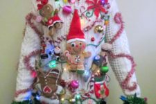 super bold white sweater with gingerbread men, stockings, mittens and flowers
