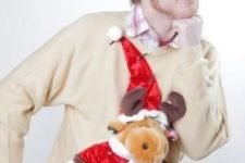 sweater with a plush reindeer in a hat