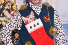 ugly sweater with a stocking and a kitty and a hat