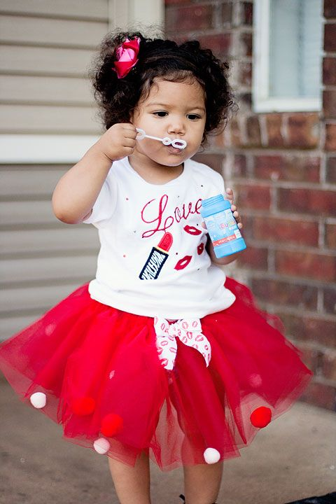 a hot red tutu with polka dots, a printed tee