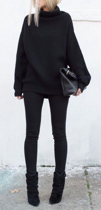 all-black look with a chunky knit sweater and ankle boots