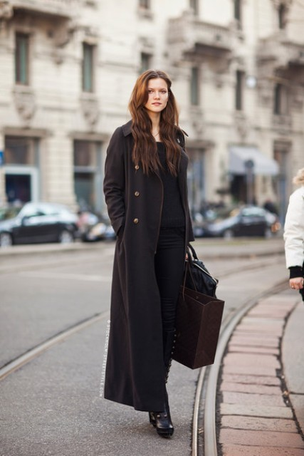 a long coat, a black sweater, keen-high boots