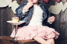 03 a pink ruffled skirt, a white top and a denim jacket