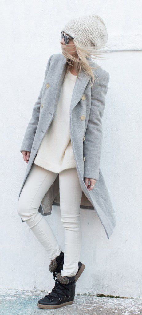white denim and sweater, a long grey coat and flat boots