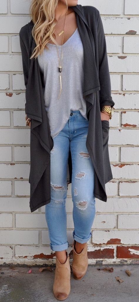 blue ripped jeans, camel booties, a grey tee and an overiszed black cardigan