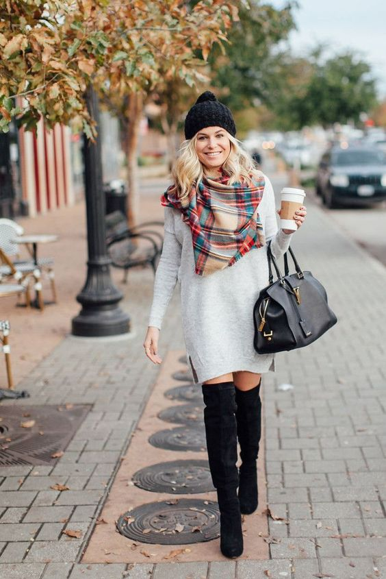 pair a sweater dress with an over the knee boot, a scarf and a beanie for ultimate street style