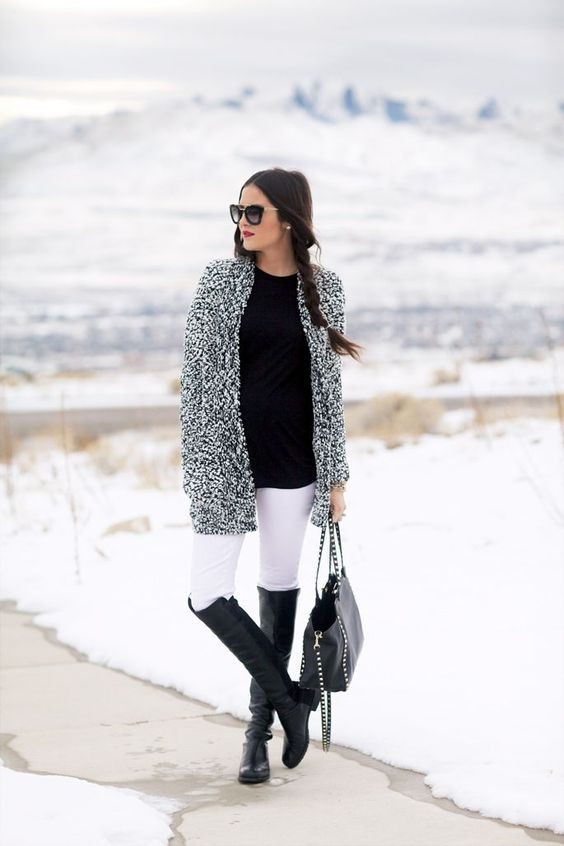 white jeans, a black tee, flat boots and a fluffy cardigan