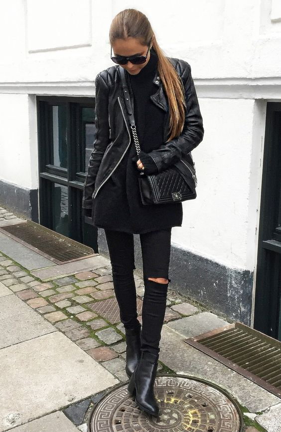 a long top, black denim, a laether jacket and boots