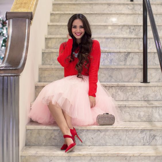 blush pink tutu, a red sweater and heels, a statement necklace