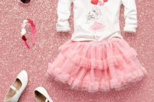 06 pink ruffled tulle skirt, a printed heart swetshirt and white shoes