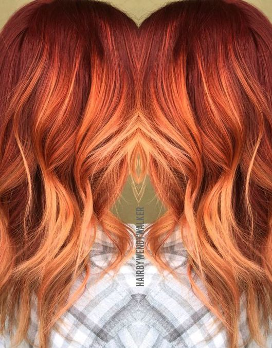 red rose gold balayage with an ombre effect