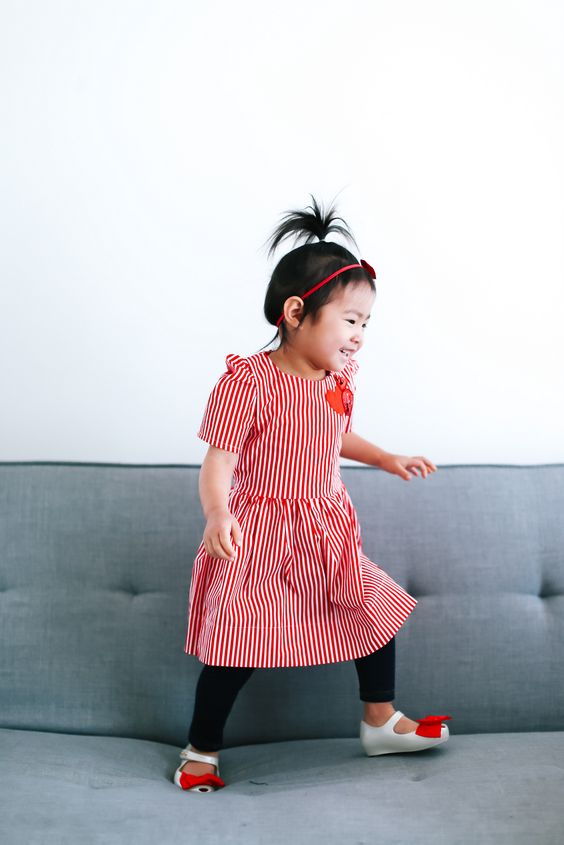 red vertical stripe dress, black leggings and flat sandalds