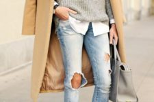 07 ripped jeans, lace up heels, a grey sweater over a shirt and a camel coat
