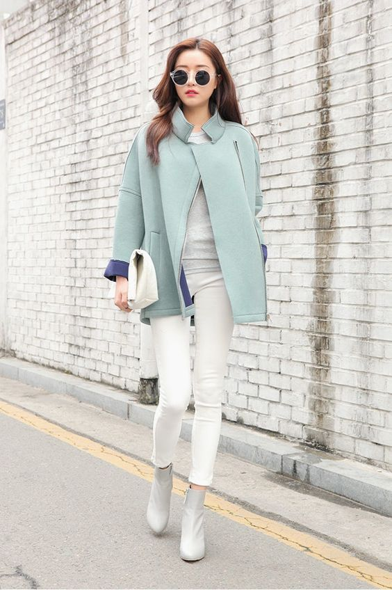 white jeans, a grey tee and booties, a short mint coat