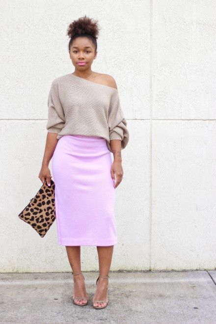 neon pink midi skirt and a neutral one shoulder sweater