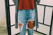 08 ripped jeans, a red top, a grey cardigan and ankle booties