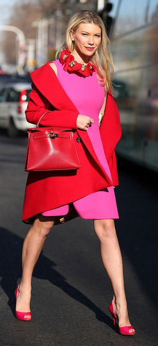 bold pink dress, fuchsia heels and a red coat and bag
