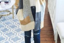 09 navy ripped jeans, grey lace up shoes and a color block cardigan