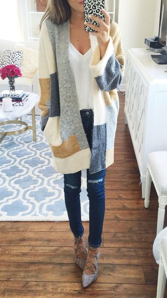 navy ripped jeans, grey lace up shoes and a color block cardigan