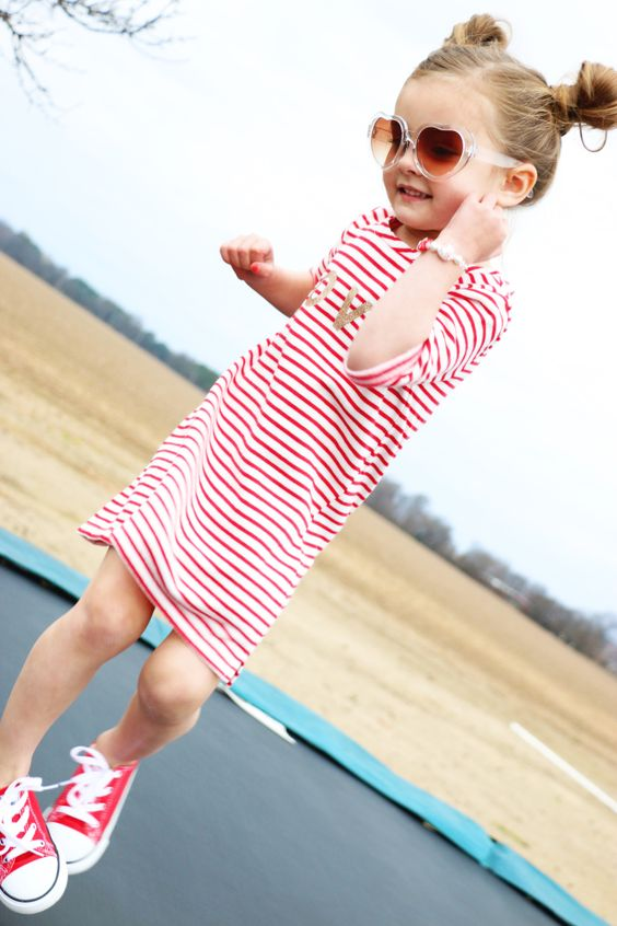 a striped red and white dress and red Converse for a cool look