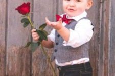 10 black jeans,a white shirt, a tweed vest and a red bow tie