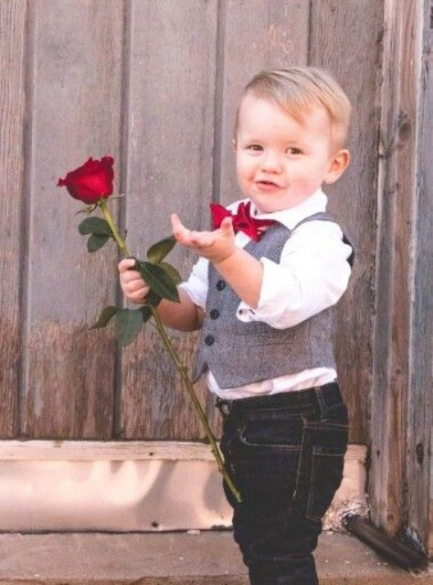 black jeans,a white shirt, a tweed vest and a red bow tie