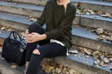 10 black ripped jeans, brown suede booties and an army green sweater