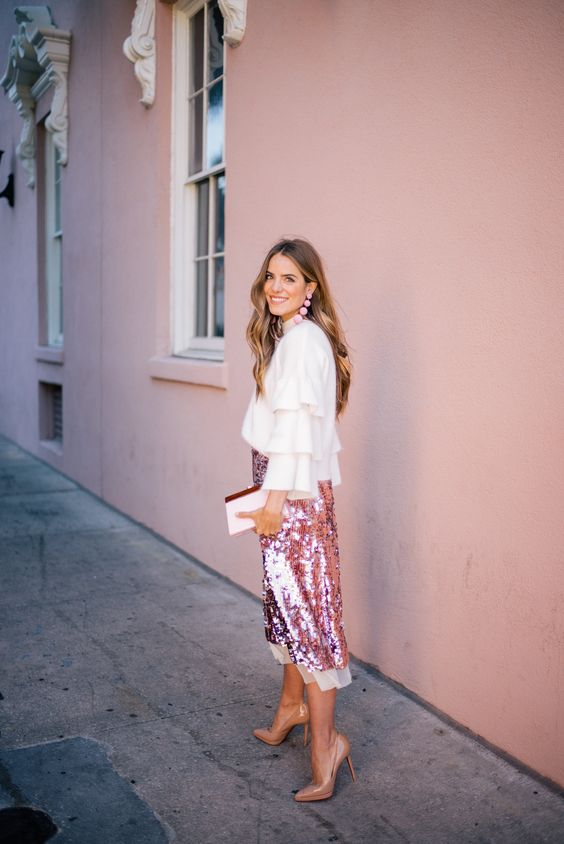 pink sequin skirt, a ruffled shirt and nude heels