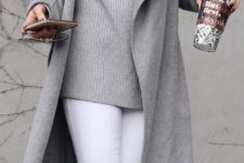 10 white jeans, grey ankle boots, a grey sweater and a long coat