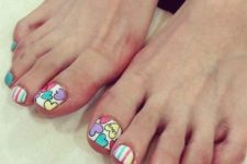 11 colorful toe nails with stripes and hearts