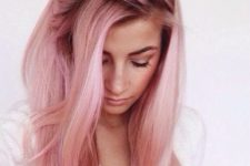11 pink straight hair with darker roots and an ombre effect to blonde