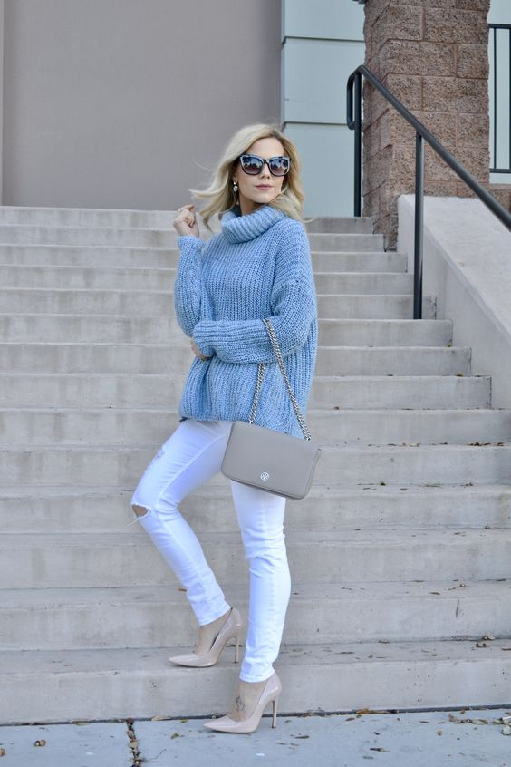 ripped white denim, an oversized blue sweater and blush heels