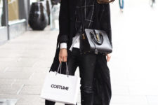 12 a black sweater, a white shirt, a black coat and black denim