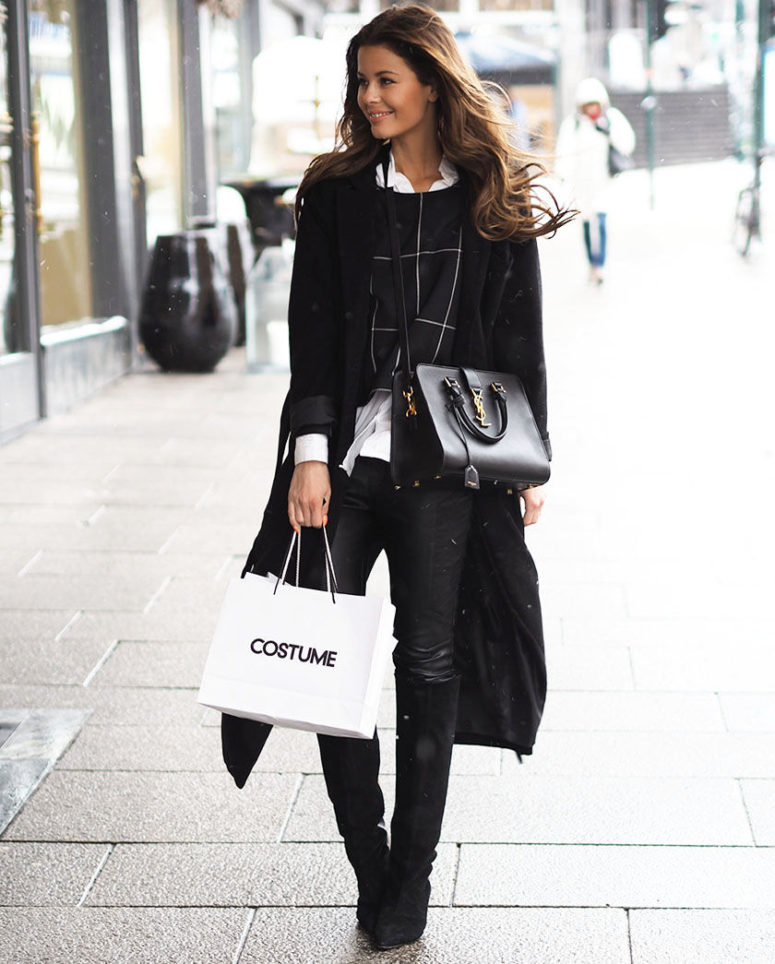 a black sweater, a white shirt, a black coat and black denim