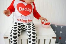 12 a black, white and red look with heart-printed pants, a printed sweatshirt, flats