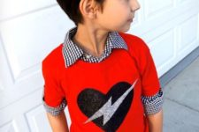 12 dark denim, a gingham shirt and a red sweater with a glitter heart