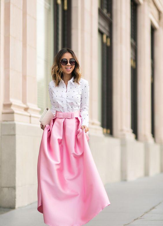 pink maxi ball gown skirt, a polka dot shirt and a clutch