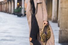 14 a black tee, black ripped jeans, white sneakers and a camel coat