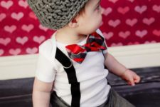 14 grey pants with hearts, a white tee, suspenders, a striped bow tie and a beanie