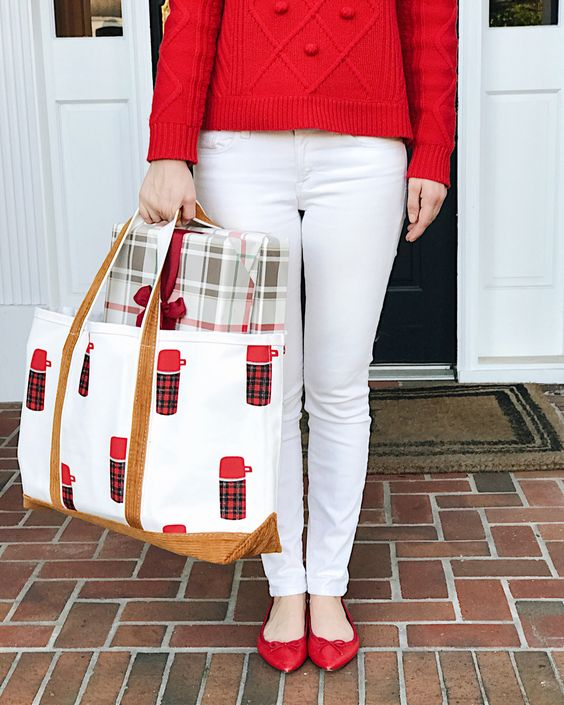 white denim, a red sweater and flats