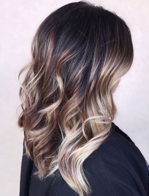 black hair with caramel and blonde balayage