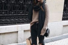 15 black ripped jeans, a brown oversized sweater and an oversized scarf, sneakers