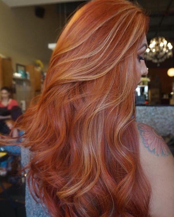 copper hair with blonde highlights to give it a dimension