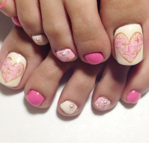 pink and white nail art with beads and hearts