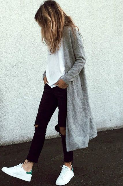 black ripped jeans, a white teem sneakers and a long grey cardigan