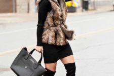 16 fux fur vest, belted and layered over long-sleeve sweater and over-the-knee boots